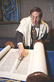 Jewish Holidays:  Rabbi reading Torah